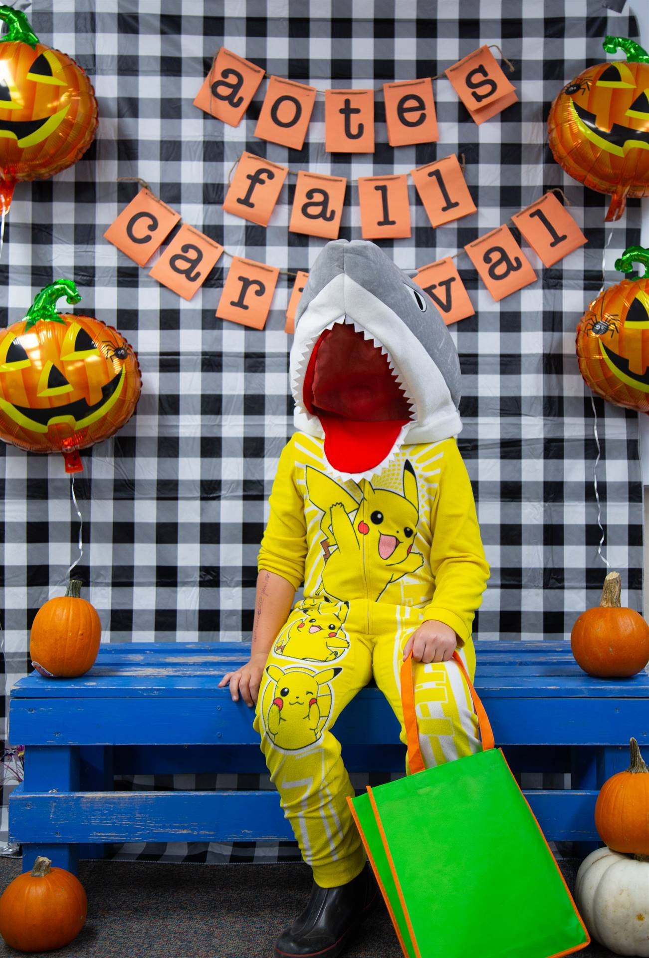 a boy in a shark costume