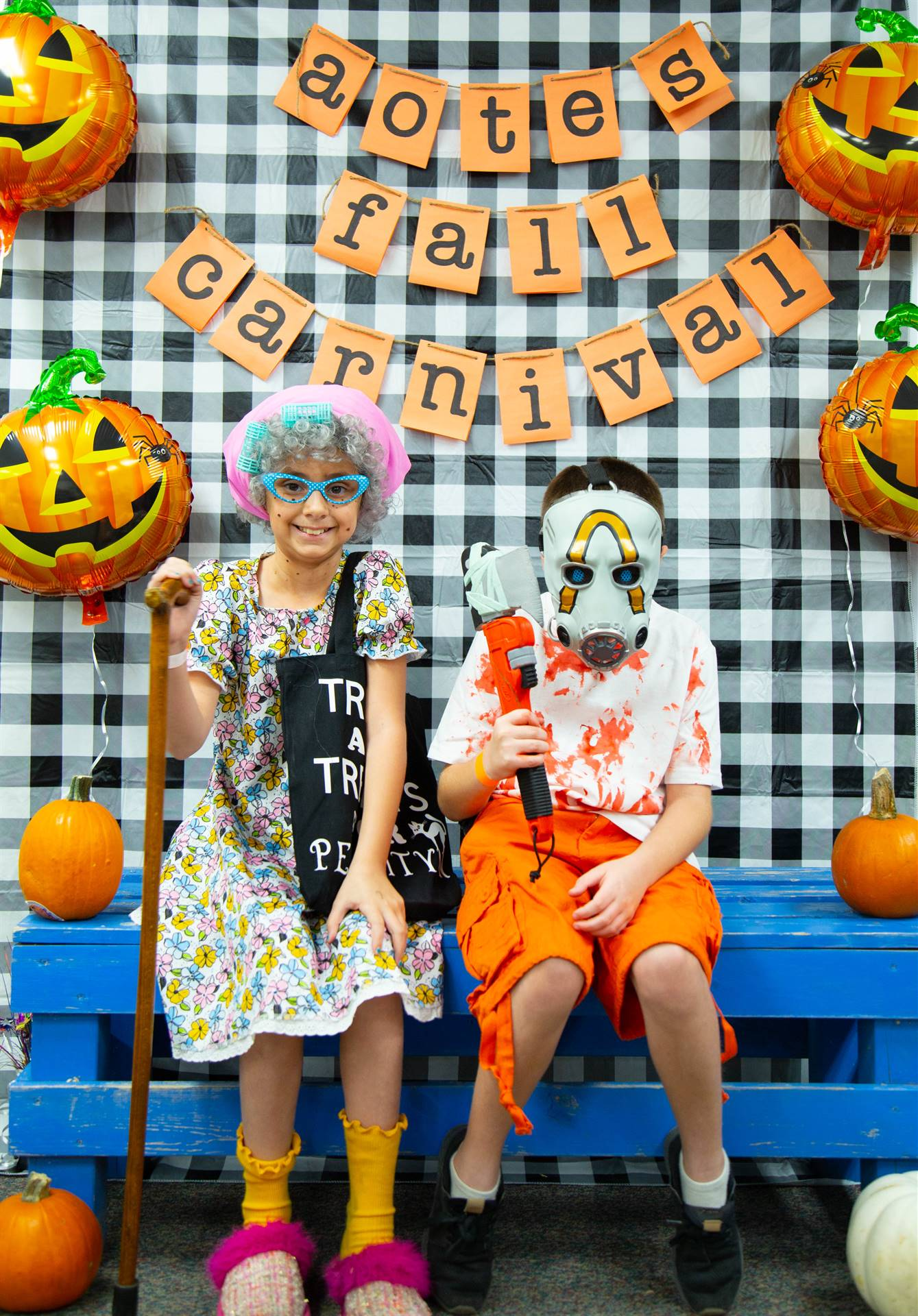 kids dressed in costume sit at photo booth