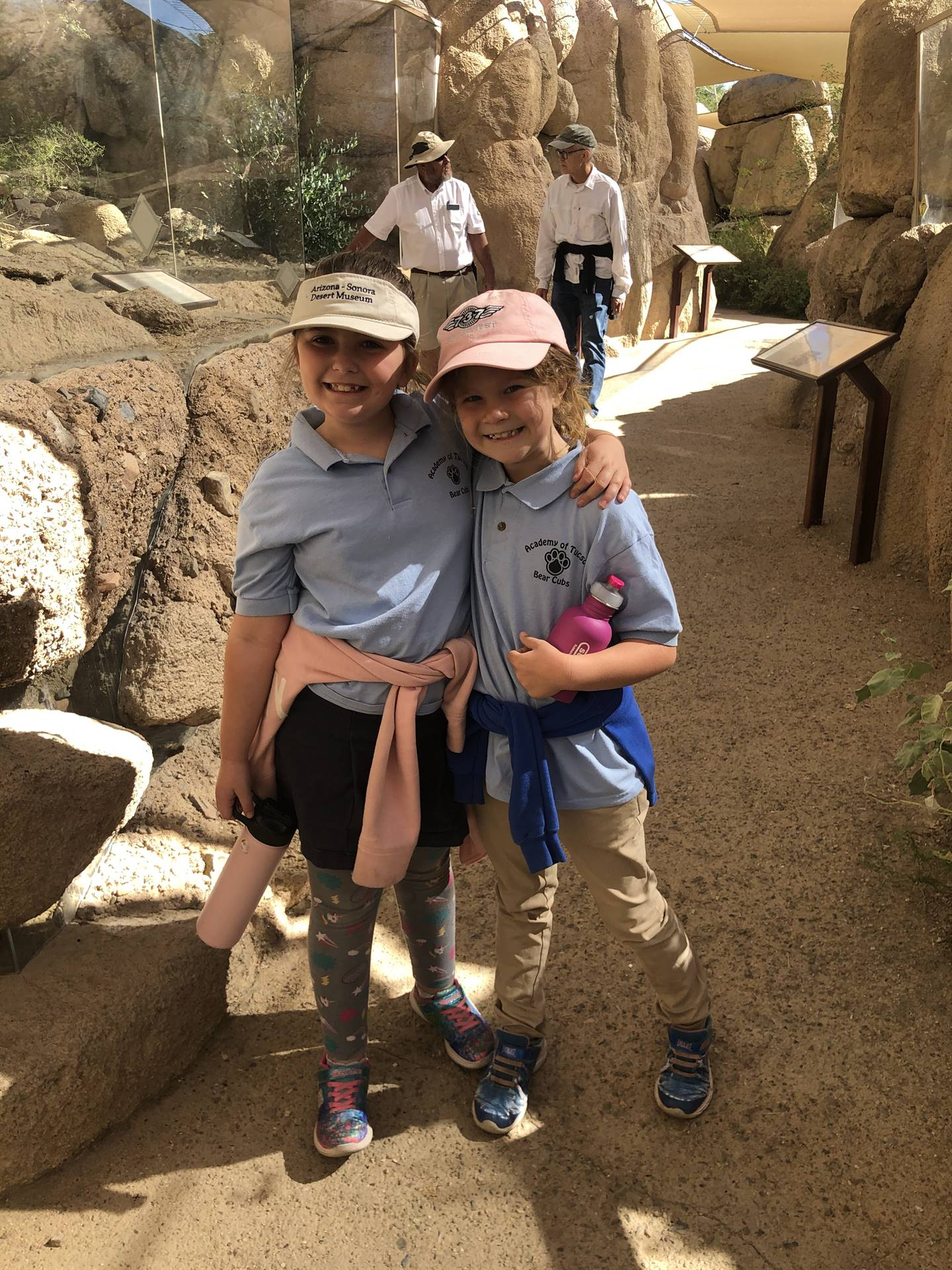 2 students pose for a desert museum picture