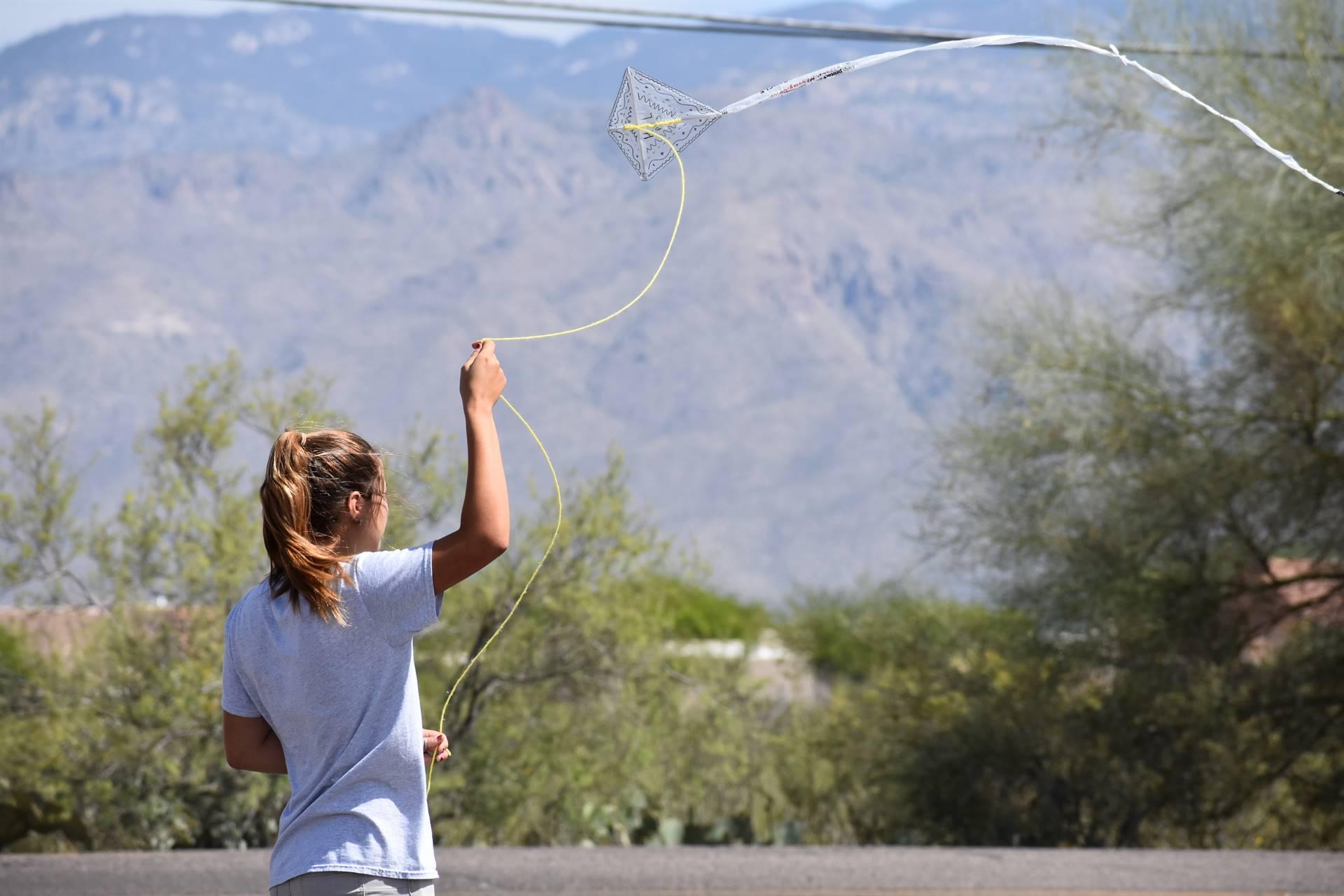 Student flying kite