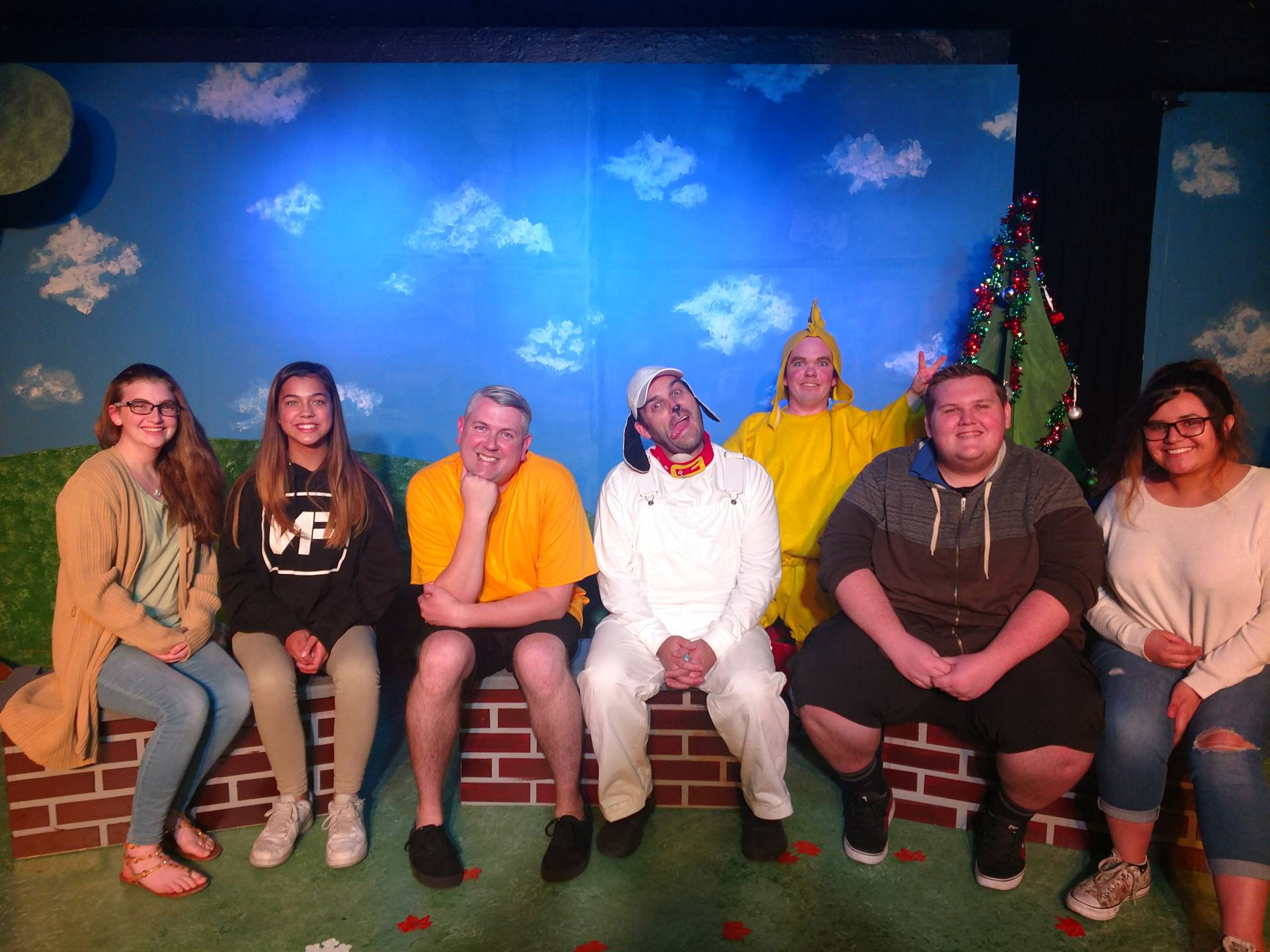 Students sitting with the cast of SNOOPY at Live Theatre Workshop