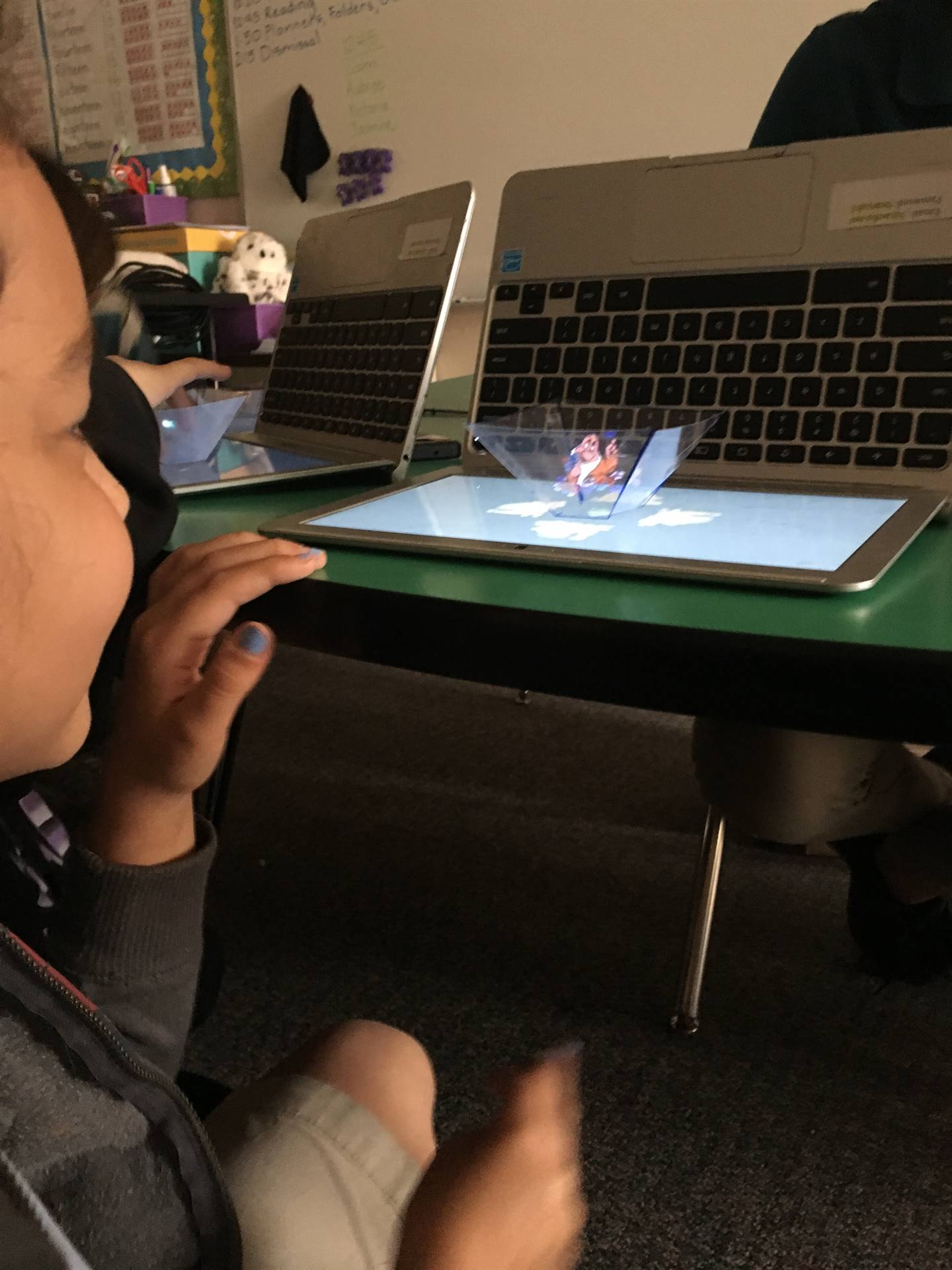 A student watches a hologram