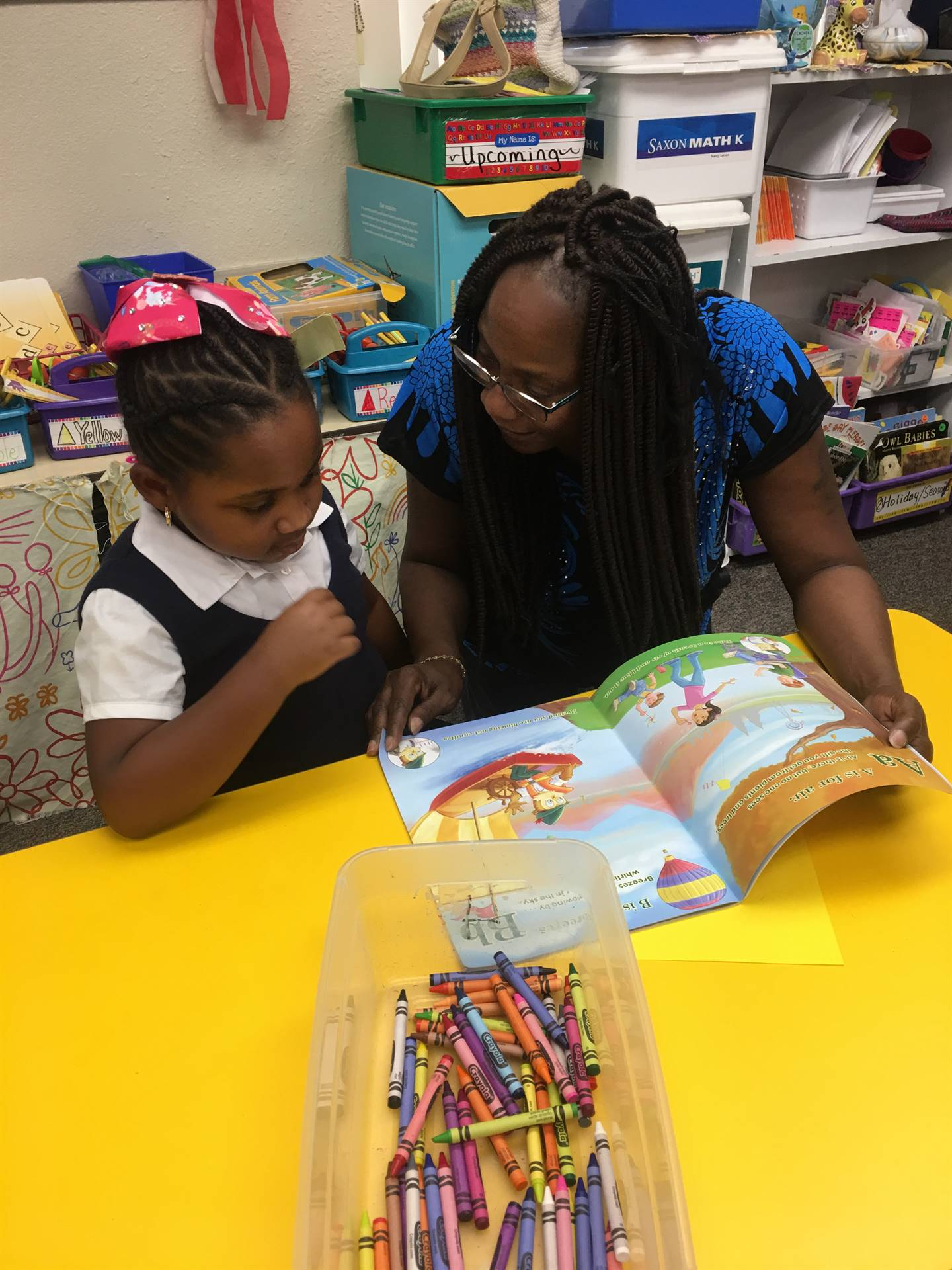 student shares a story with her grandparent